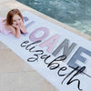 dusty hues girls name beach towel by pool