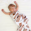 rust floral baby name swaddle