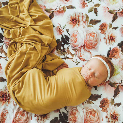 mustard super soft newborn swaddle