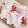 white newborn knotted gown with buttons