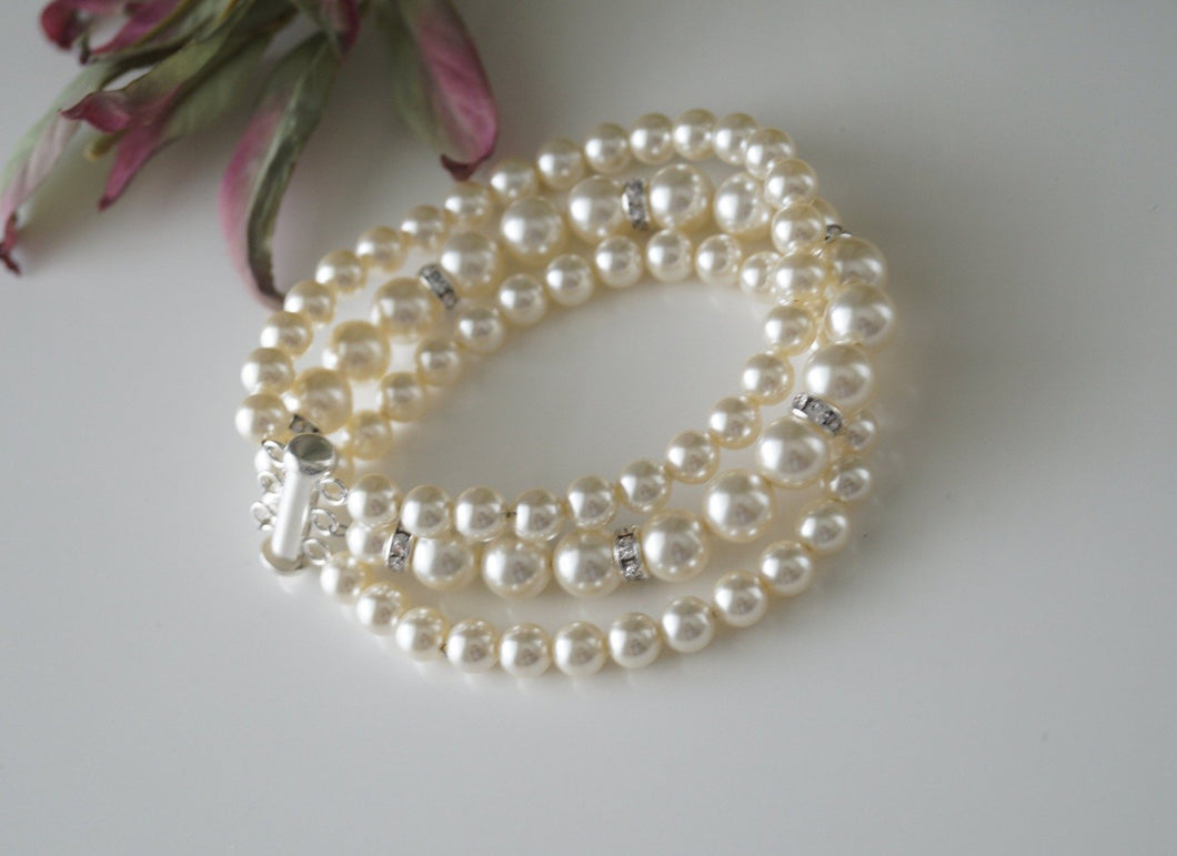Three Strand Pearl and Rhinestone Bracelet Wedding Jewelry - Clairesbridal - 1