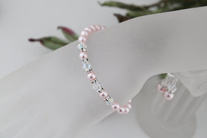 pink pearl bracelet and earrings