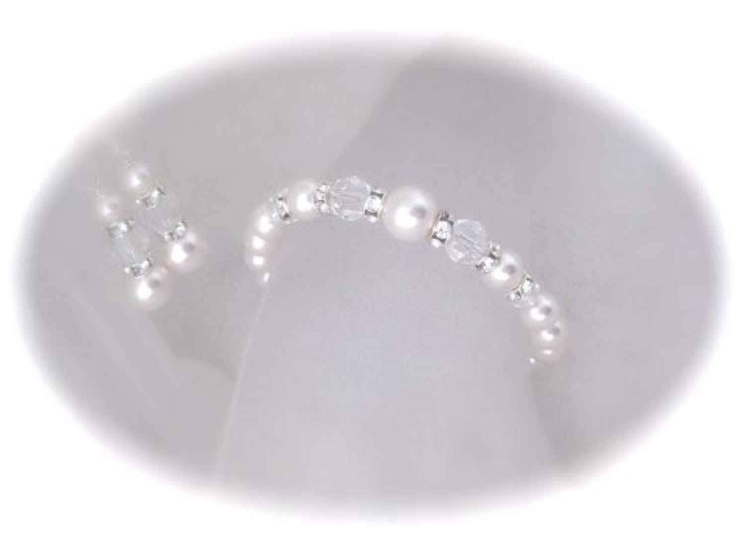 White pearl and crystal bracelet and earrings made with Swarovski elements - Clairesbridal - 1