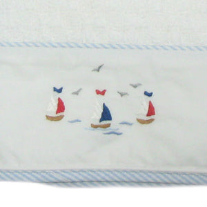 sailing away baby blanket with blue stripe trim