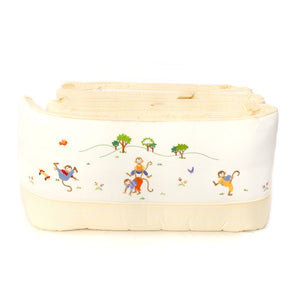 white monkey business crib bumper with yellow stripe trim