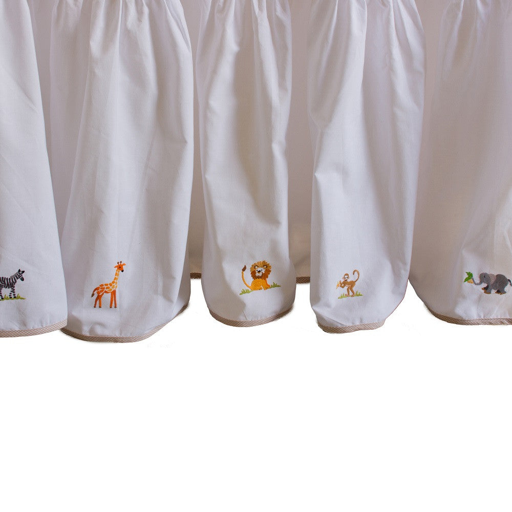 white on safari crib dust ruffle with beige trim