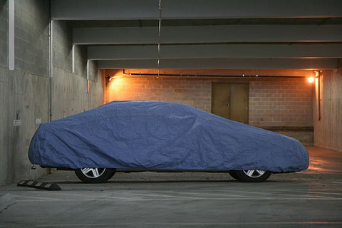 Preparing a Vehicle for Winter [Storage] image of covered car in storage unit