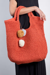 burnt slouchy straw bag with pom pom