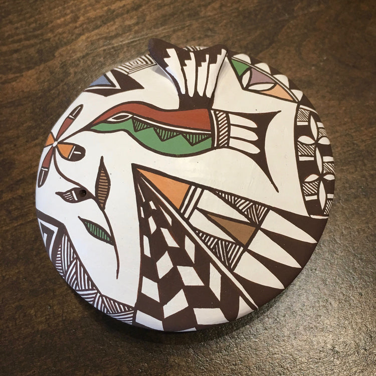 Hummingbird Acoma Pot, by Carolyn Concho, at Raven Makes Gallery