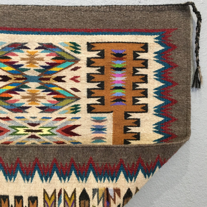 Traditional Storm Pattern Navajo Rug with Vibrant Jewel Colors, by Bessie Littleben