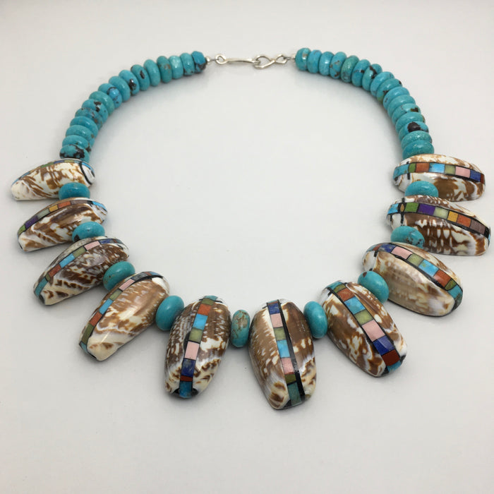 Santo Domingo Jewelry by Mary Tafoya at Raven Makes Gallery
