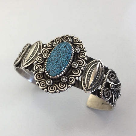 Kingman Webbed and Sterling Silver Navajo Bracelet, by Ivan Howard, at Raven Makes Gallery
