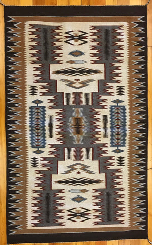 Earth Tones Storm Pattern Navajo Rug, by Nora Manybeads