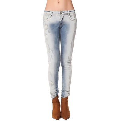 Light Wash Jeans With All Over Rips & Distressing Women - Apparel - Denim - Jeans