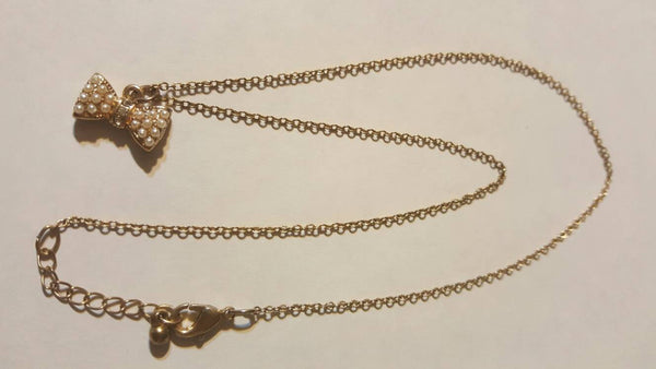 Gold Bowtie Charmed Necklace