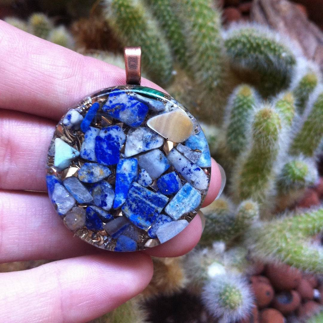 Fingerprint Orgonite® Cosmic Healing Pendants.