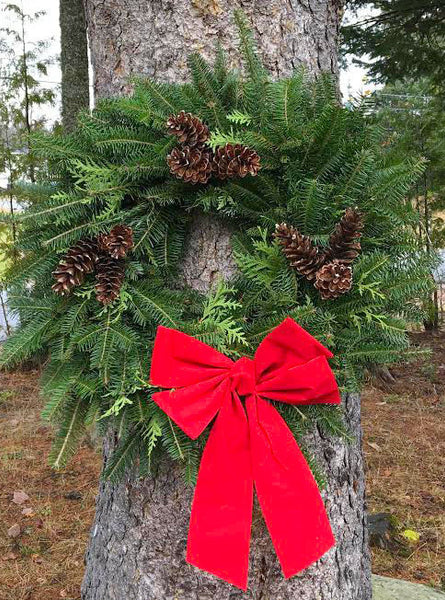 Christmas wreath made by hand hanging on tree