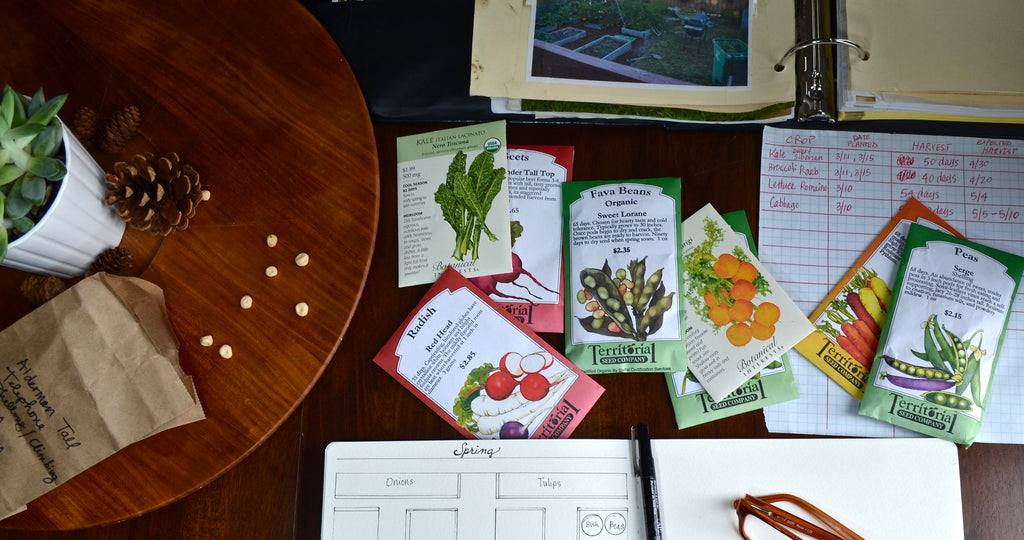 table top garden planning with garden binder and seed packets