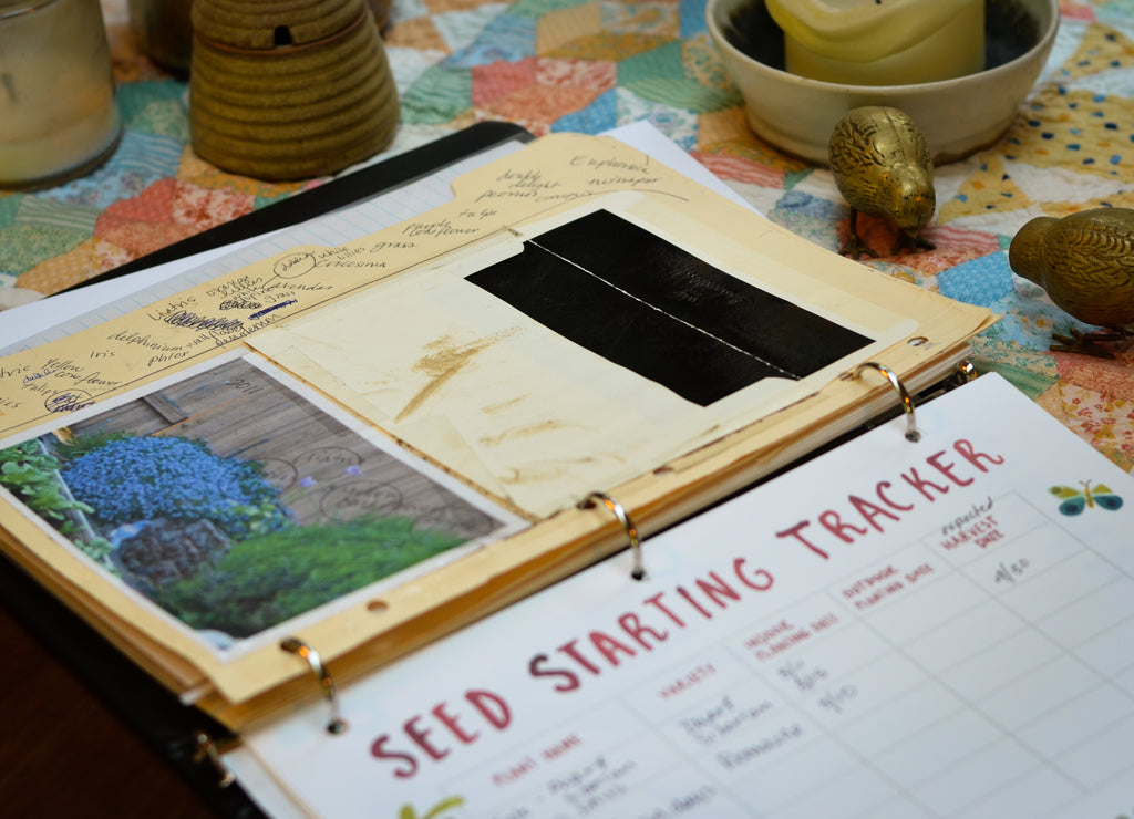 garden three ring binder with photographs and seed starting page