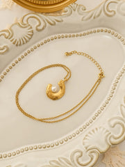 Brie C-shaped pearl horn necklace