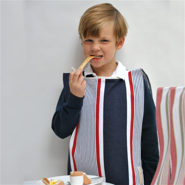 Six year old boy in Big Bib Tunic - Cotton Stripe Bigbib, Red/Blue