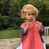 2 year old wearing Big Bib Tunic - Herringbone Bigbib, Coral/Monogram