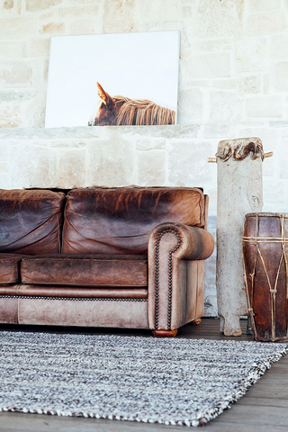 old brown couch with modern decor