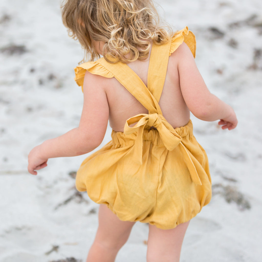 The Aylah Playsuit in Linen (Mustard)