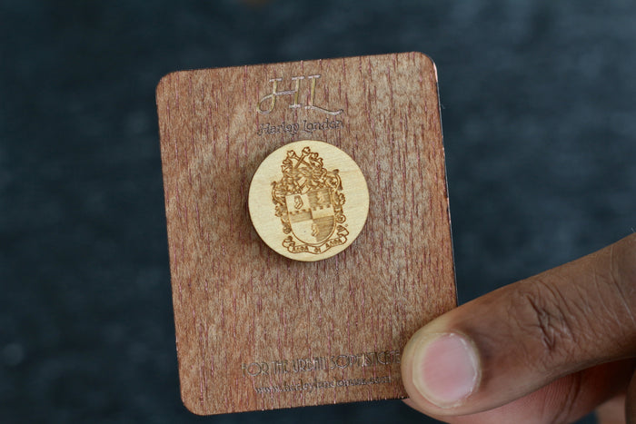 Man Holding a Greek Alpha Phi Alpha Wooden Lapel Pin