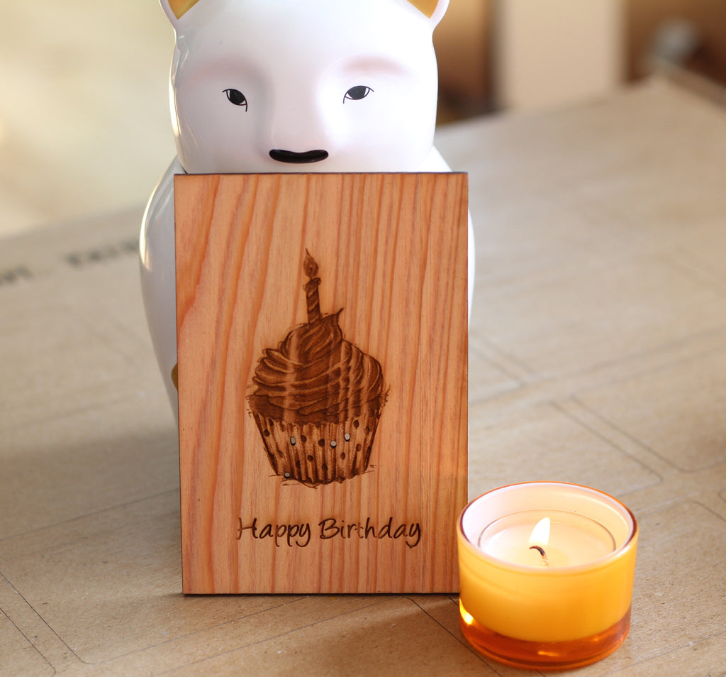 Wooden Happy Birthday Card with an adorable bear and lit candle in the background