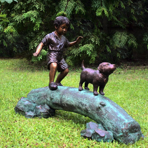Boy Following Dog Across Log Brass Baron Outdoor Statue - Outdoor Art Pros