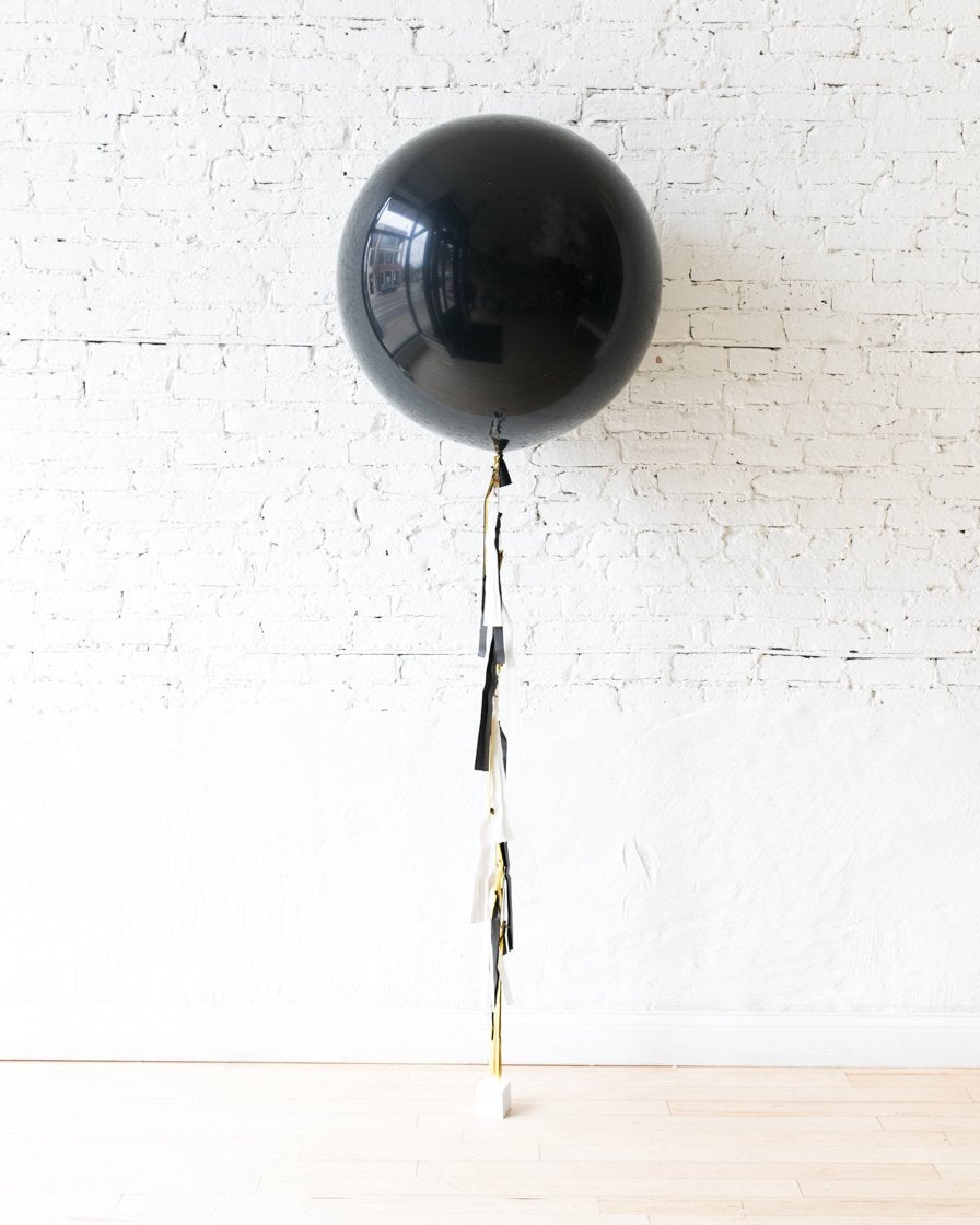 Black Giant Balloon and Black, White and Gold Tassel