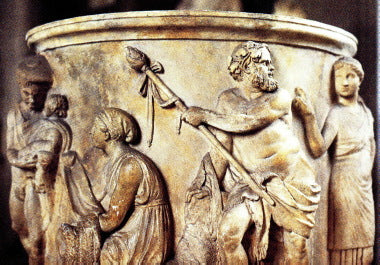 Dionysus depicted carrying a thrysus on a piece of ancient pottery.