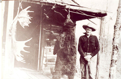 Cowboy with Hanging Bear