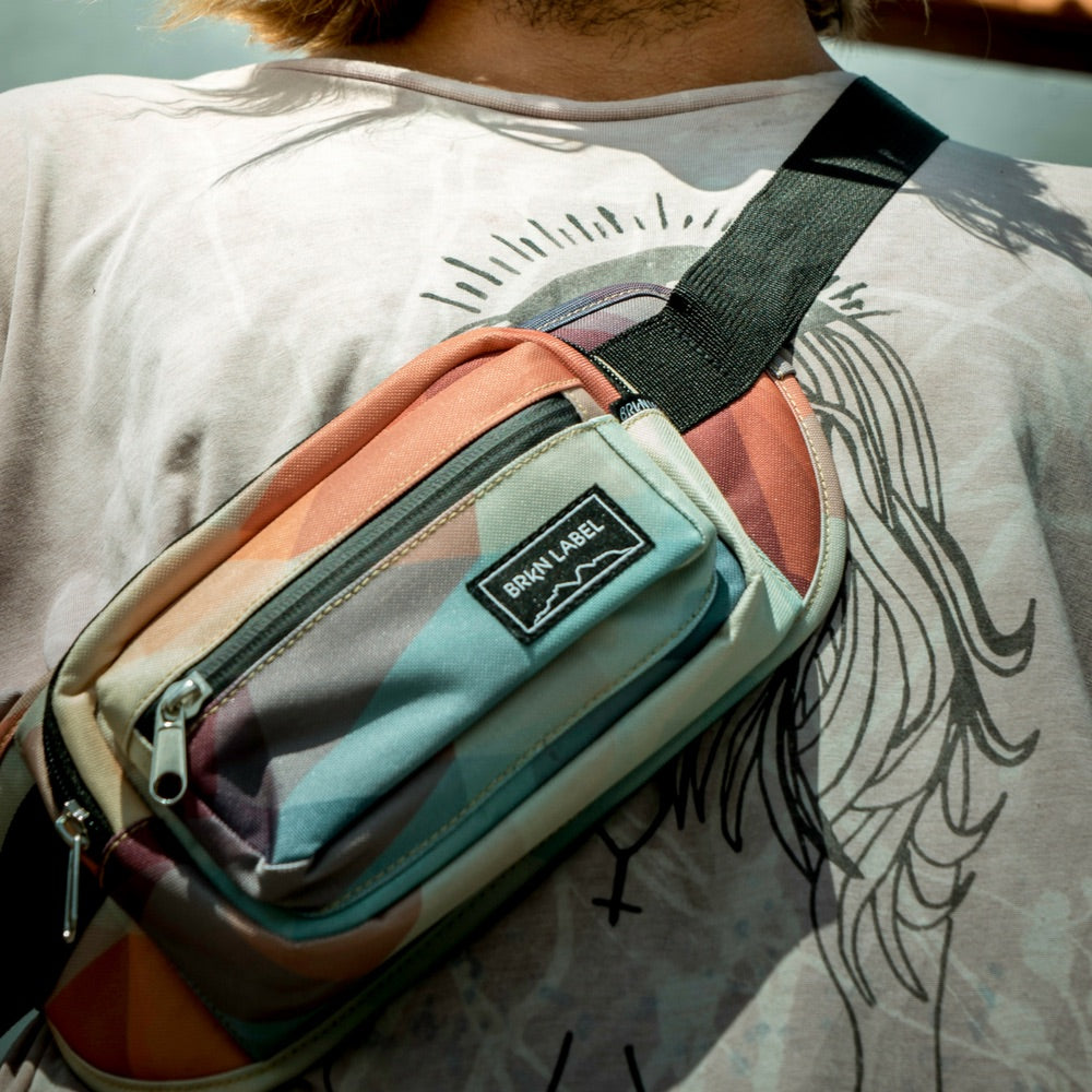 It is a photo of Dynamite Brkn Label Fanny Pack