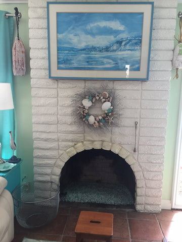 Yellow stains on white glossy brick fireplace