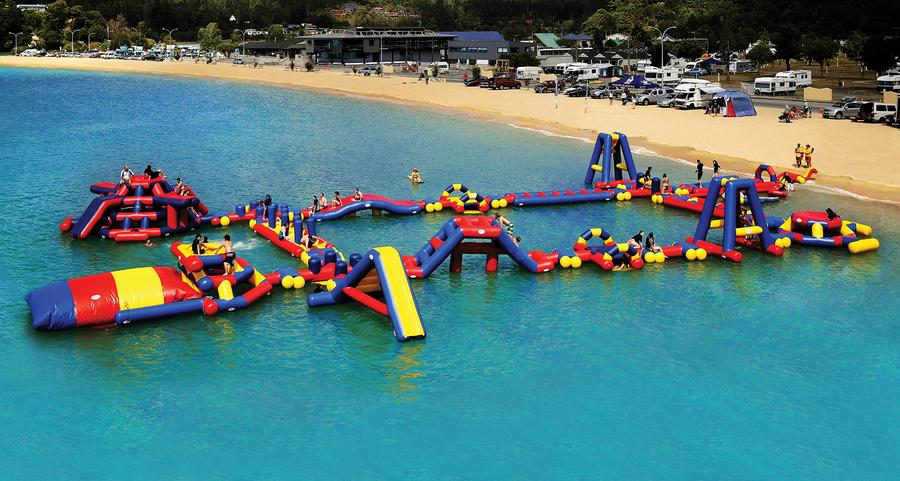 Modular inflatable waterpark in Kaiteritier New Zealand.
