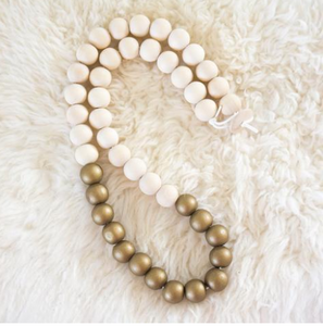 Gold and natural wooden beaded necklace