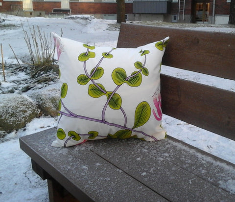 Pillow cover made from Marimekko fabric Kuusama in pink and green
