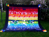 Rainbow quilt with black borders from Marimekko fabric