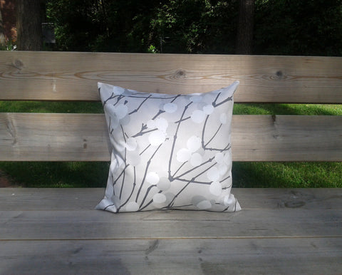 Pillow cover made from Marimekko fabric Lumimarja in grey