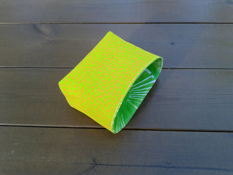 Green fabric basket made from Marimekko fabric Pirput Parput and Appelsiini