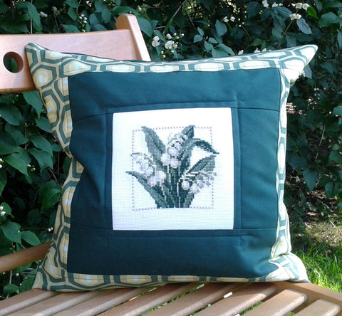 Green hand embroidered pillow cover with Lilly of the valley