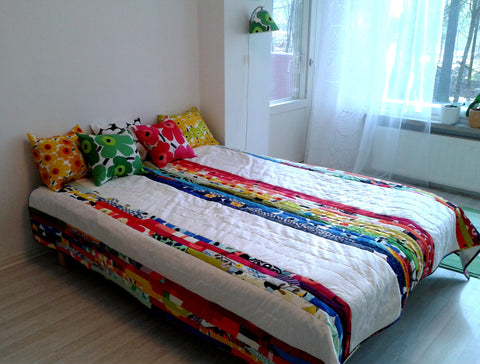 Rainbow patchwork quilt made from Marimekko fabric