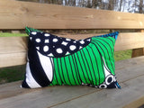 Modern green accent pillow made from Marimekko fabric Siirtolapuutarha
