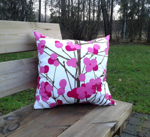 Pink pillow cover made from Marimekko fabric Lumimarja