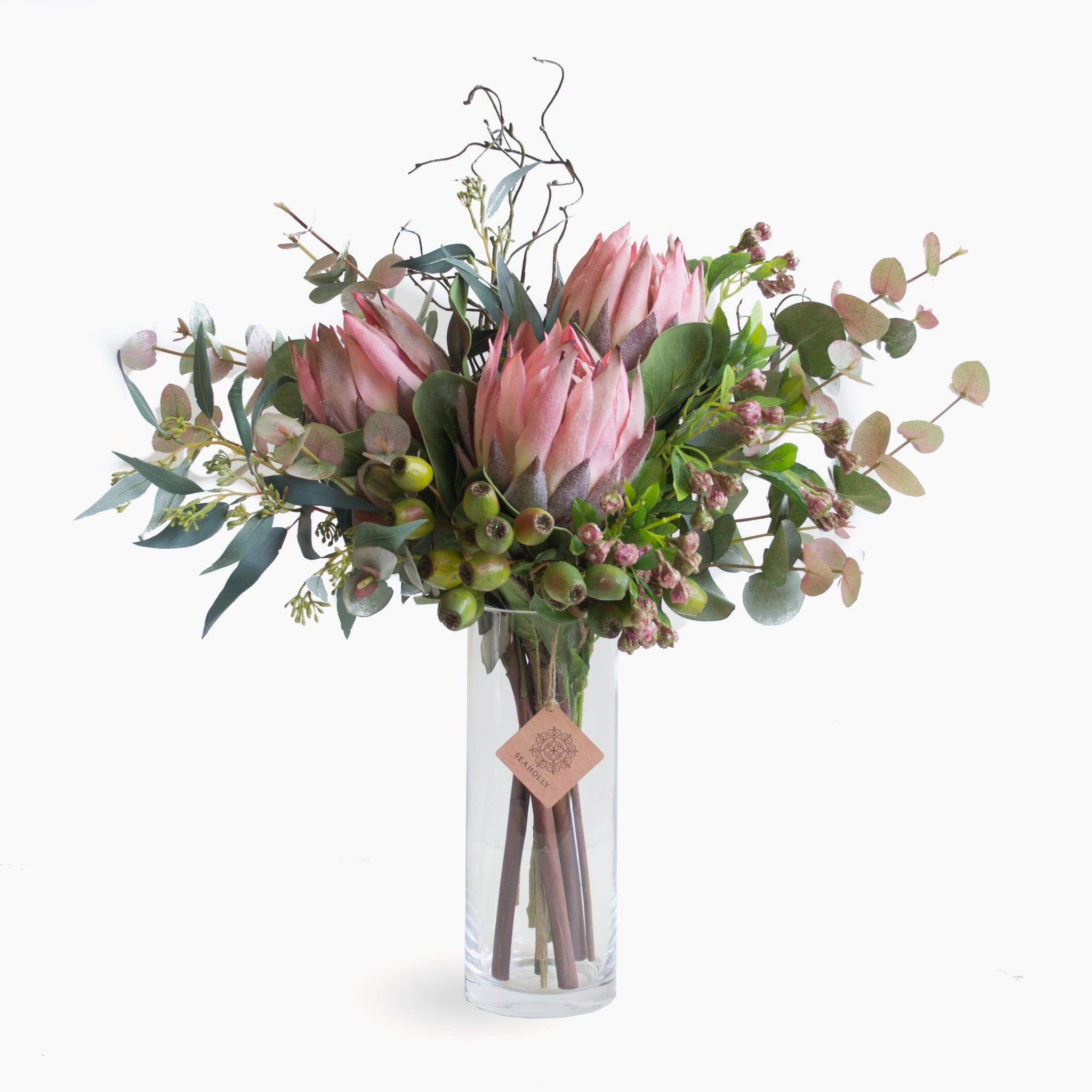 Pink protea, eucalyptus pods, gum nuts, curly twig and mixed foliage