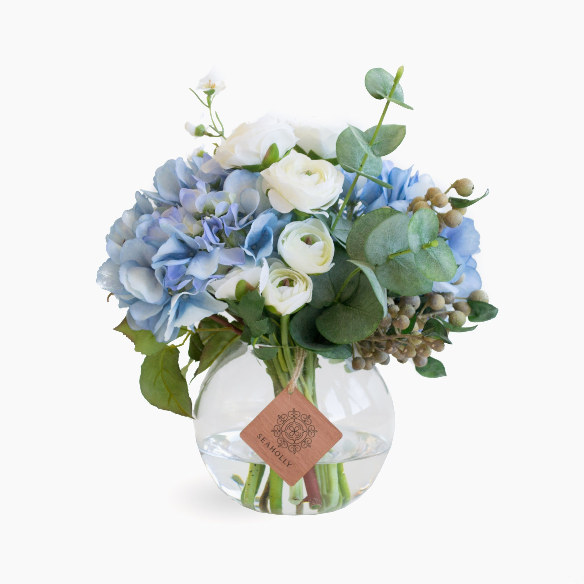 Blue hydrangea, ranunculus and roses