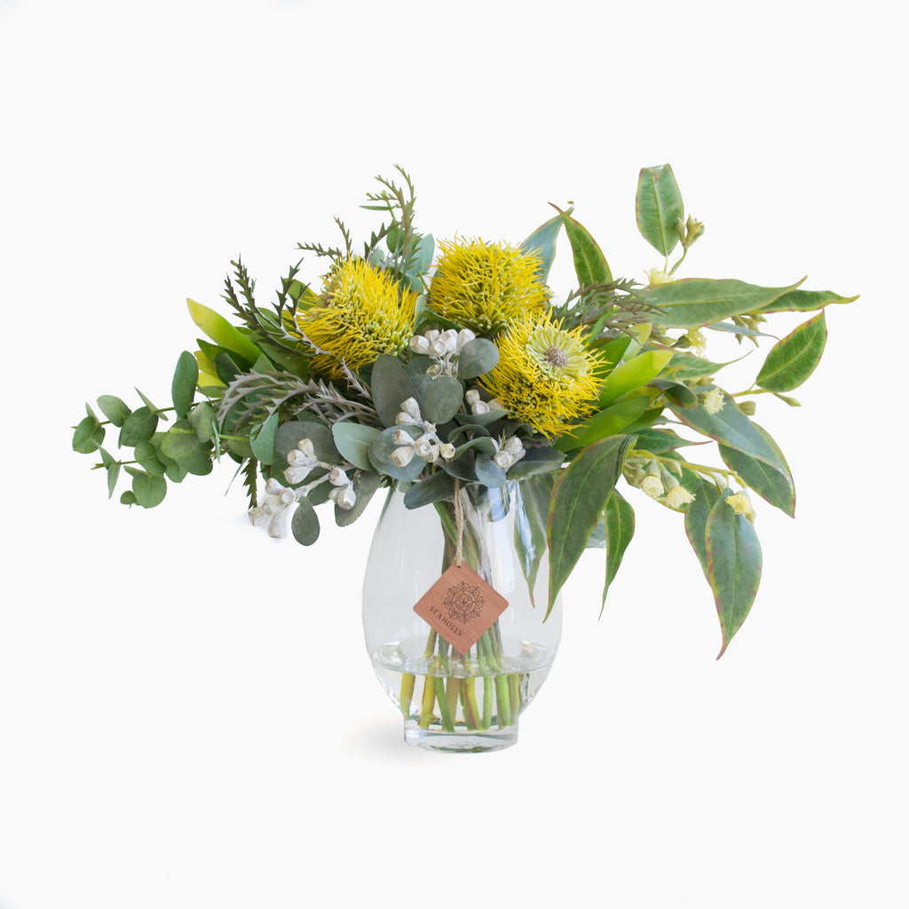 Yellow leucospermum, leucadendron and tetra nuts