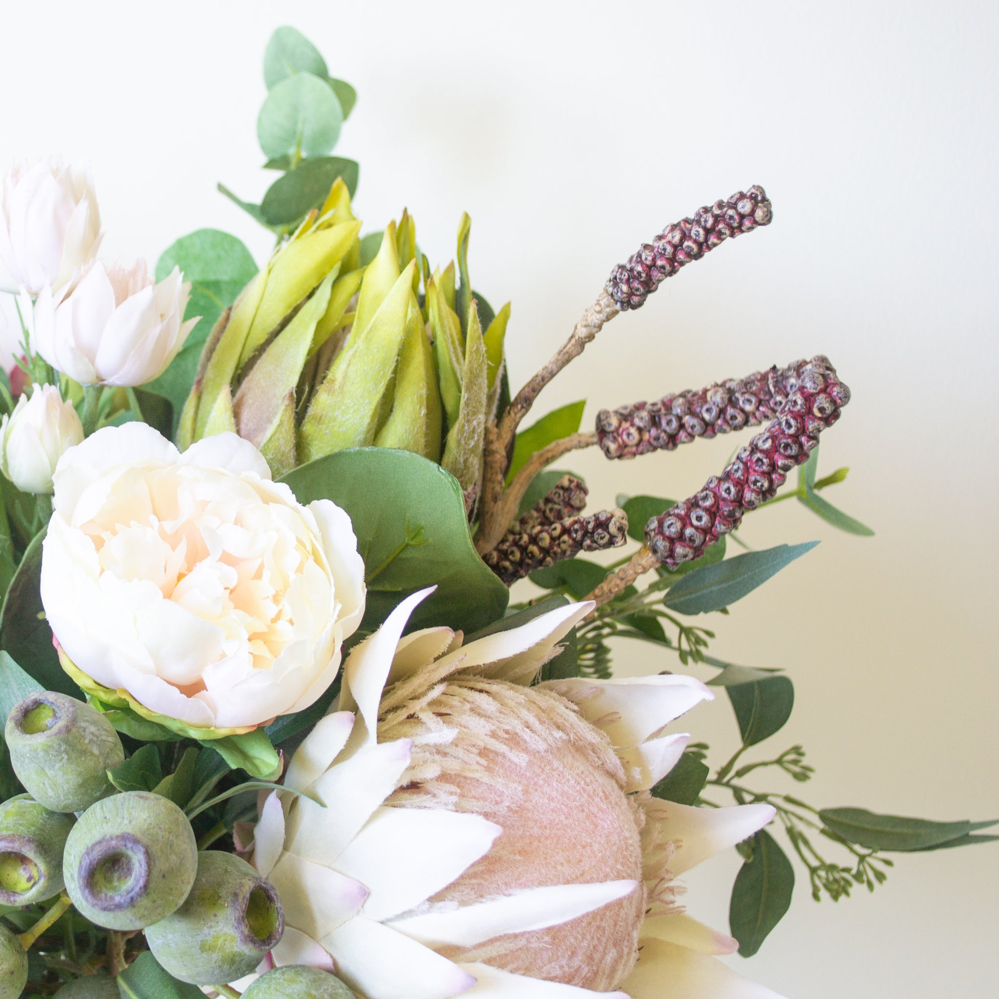 King protea, peony, leucadendron and blushing brides with bottle brush pods